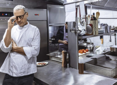 this photo shows a worried chef who is thinking of selling his restaurant