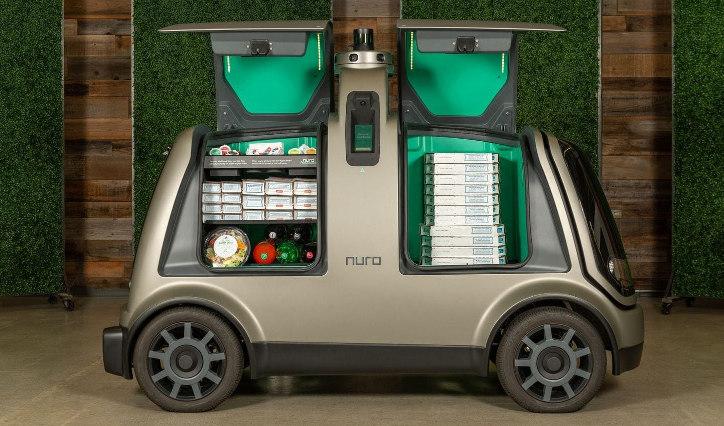 this is a photo of an earlier model of Nuro's self-driving pizza delivery car designed for Domino's
