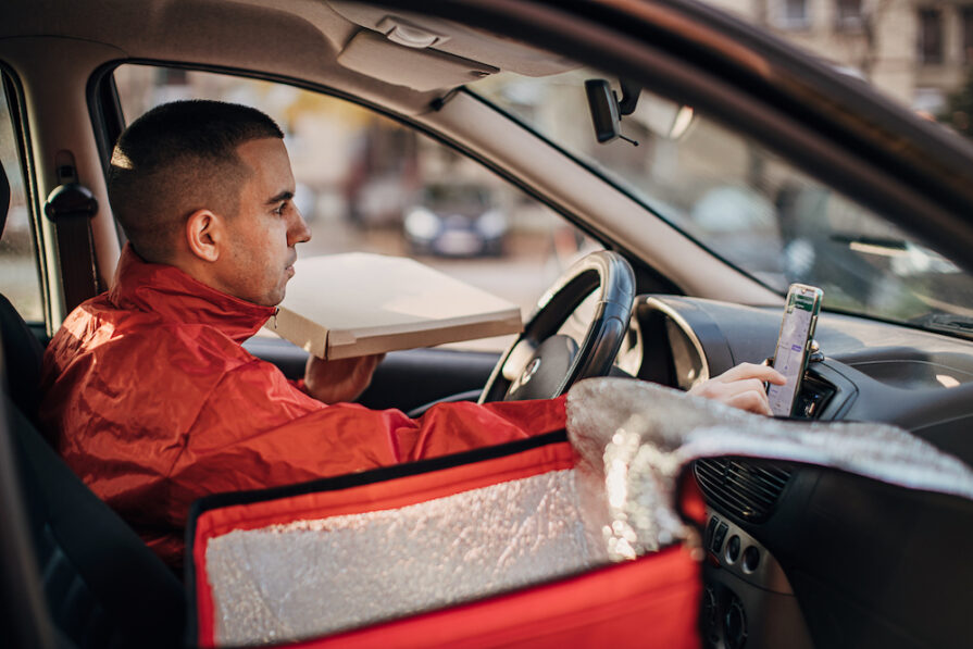 this photo shows a pizza delivery driver who could pose a risk for a restaurant owner