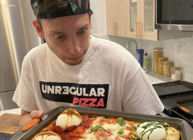 this photo shows Gabriele Lamonaca of Unregular Pizza staring in amazement at one of his unique pizza creations