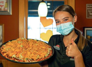 this photo shows an attractive female server at Happy Joe's Pizza and Ice Cream
