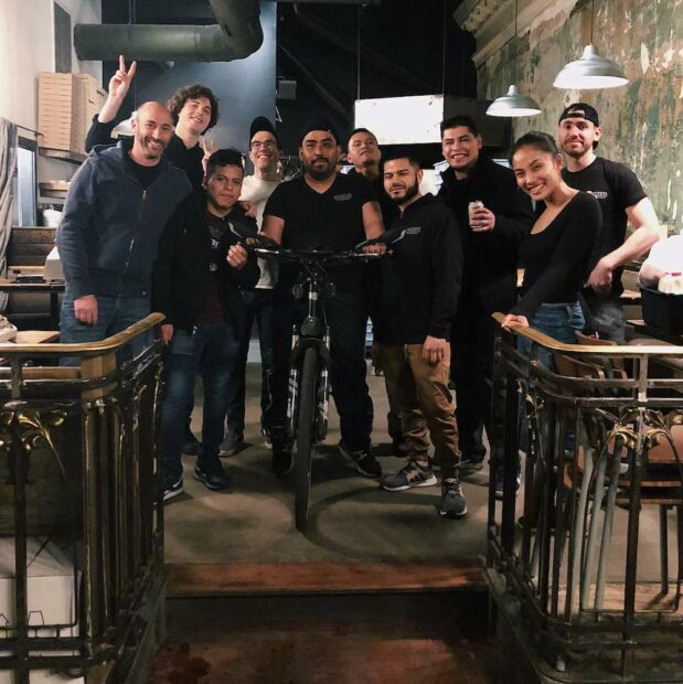 this photo shows the crew of Razza in Jersey City, located in one of the best pizza states in the U.S.