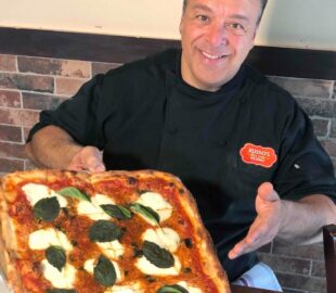 this photo shows Chef Anthony Russo displaying a tasty-looking Margherita pizza