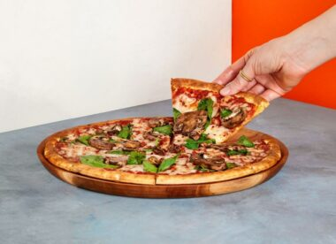 this photo shows a pizza built on a vegan and gluten-free chickpea crust from Banza
