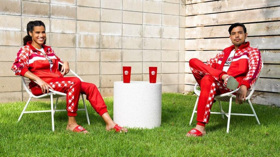 this photo shows two models clad in Pizza Hut's Tastewear street attire