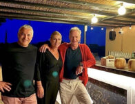 this photo shows rock star Sting with staff at his new pizzeria and wine bar in Tuscany, Italy