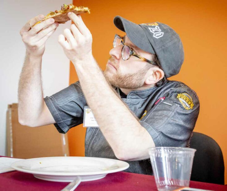 this photo shows a judge in the 2020 Real California Pizza Contest