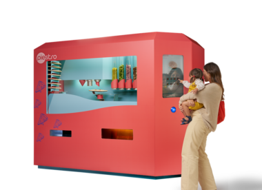 this photo shows a mother and her child ordering pizza from the robotic system from Piestro