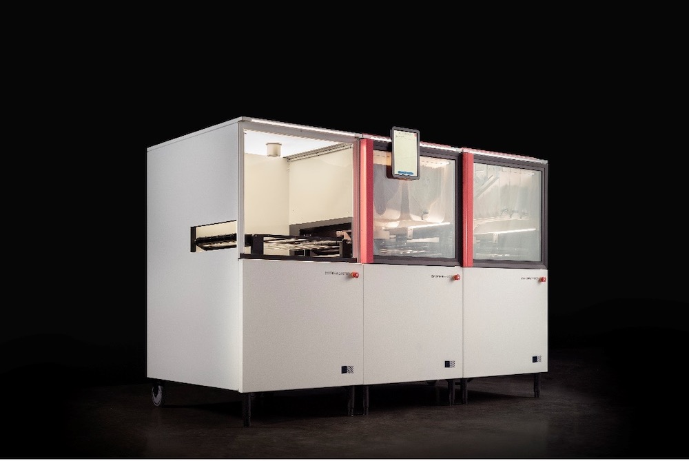 this photo shows the full Picnic Pizza System, a pizza-making robot