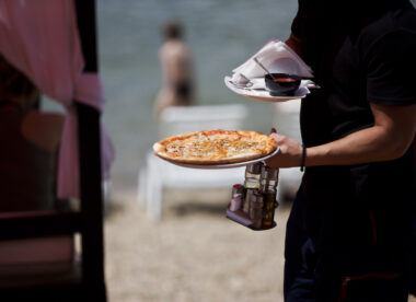 This photo of a hard-working pizzeria server shows why the restaurant job market is suffering