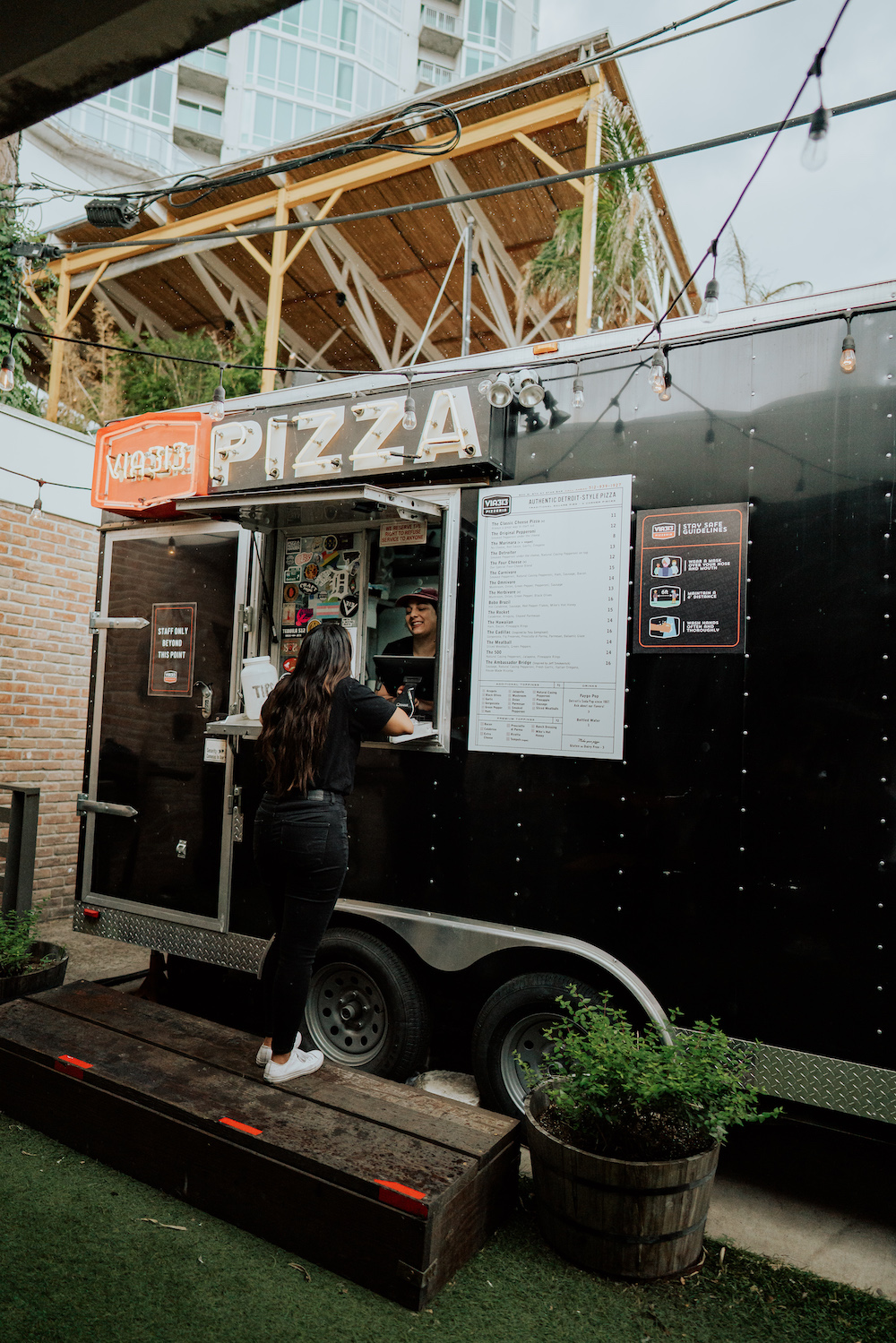 this photo shows a customer ordering from a Via 313 food trailer in Austin, Texas