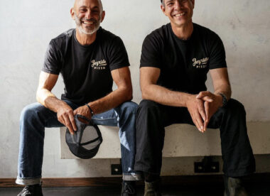 this photo shows Jesse and Joshua Jacobs, founders of Joyride Pizza, smiling in their logged t-shirts