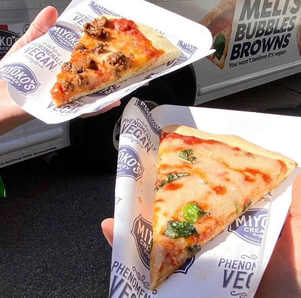this photo shows two slices of pizza made with Miyoko Creamery's Liquid Vegan Pizza Mozzarella