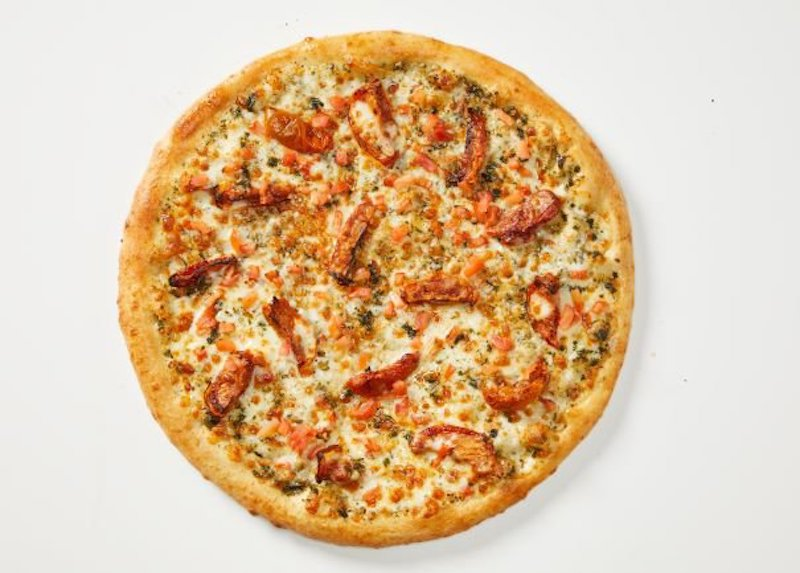 this is a pizza from Toppers featuring plant-based meat substitutes