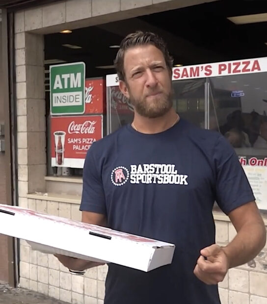 this photo shows Dave Portnoy of Barstool Sports getting ready to take one bite of a pizza